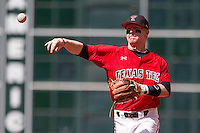 Texas Tech Red Raiders second baseman Bryant Burleson #21 makes a throw to first base during the NCAA baseball game against the Sam Houston State Bearkats on March 1, 2014 during the Houston College Classic at Minute Maid Park in Houston, Texas. The Bearkats defeated the Red Raiders 10-6. (Andrew Woolley/Four Seam Images)