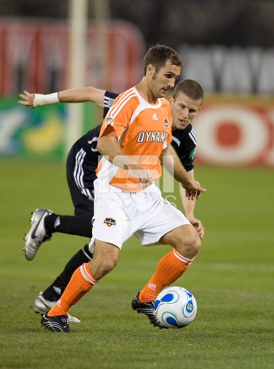 Brian Mullan carries the ball as Joshua Gros bears down. D.C. United defeated the Houston Dynamo 2-0 at RFK Stadium in Washington, D.C. on April 15, 2006