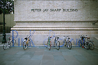 """Newly installed bike racks, designed by former Talking Heads band member David Byrne, are seen in front of the Brooklyn Academy of Music on Saturday, August 25, 2012.  The two sets of racks spell out the words in steel, """"pink crown"""" and """"micro lip"""". Byrne, an avid cyclist also designed bike racks for the Dept. of Transportation in 2008. (© Richard B. Levine)"""