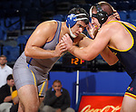 BROOKINGS, SD - NOVEMBER 9:  J.J. Everard from South Dakota State battles with Jamie Callender from Drexel in their 285 pound match Saturday at Frost Arena. (Photo by Dave Eggen/Inertia)