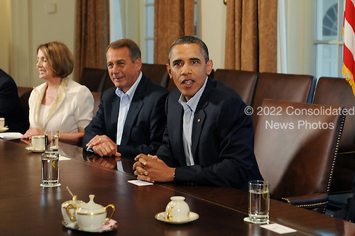 United States President Barack Obama (C) attends a meeting with Republican and Democratic Congressional leaders in the Cabinet Room of the White House, beside Speaker of the House John Boehner (2-L) and House Minority Leader Nancy Pelosi (L), in Washington DC, USA, Sunday, 10 July 2011. Congressional leadership on both sides of the aisle met with President Obama at the White House, 10 July 2011, to negotiate a plan for deficit reduction and raising the national debt limit..Credit: Michael Reynolds / Pool via CNP