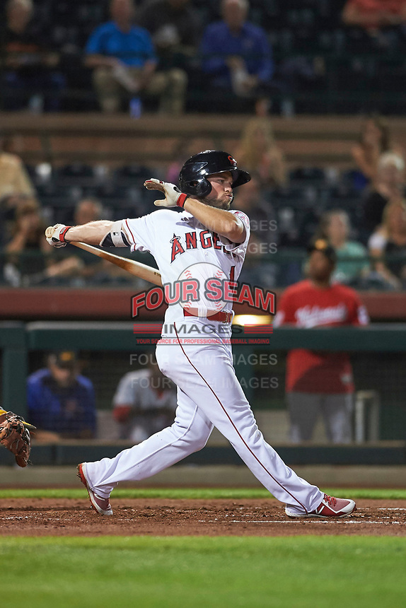 Scottsdale Scorpions right fielder Troy Montgomery (4), of the Los Angeles Angels organization, follows through on his swing during an Arizona Fall League game against the Mesa Solar Sox on October 23, 2017 at Scottsdale Stadium in Scottsdale, Arizona. The Solar Sox defeated the Scorpions 5-2. (Zachary Lucy/Four Seam Images)