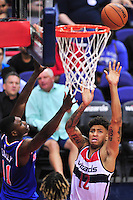Otto Porter of the Wizards takes it to the rim against Knicks' Carmelo Anthony.  New York defeated Washington 115-104 during a NBA preseason game at the Verizon Center in Washington, D.C. on Friday, October 9, 2015.  Alan P. Santos/DC Sports Box