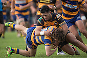 Sam Furniss get taken to ground by David Osofua. Counties Manukau Premier Club Rugby game between Patumahoe & Bombay, played at Patumahoe on Saturday June 18th 2016. Patumahoe won the game 27 - 15 after leading 9 - 3 at halftime. Photo by Richard Spranger.
