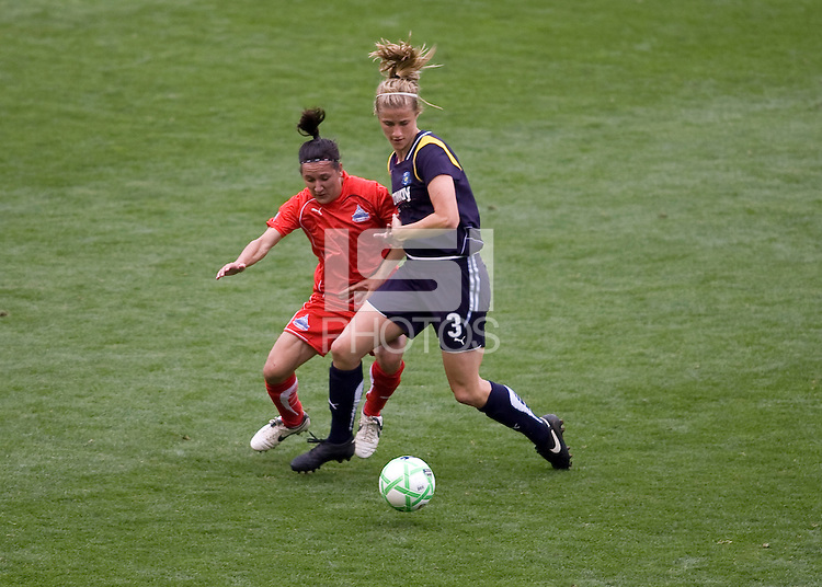 LA Sol's Allison Faulk battles Washington Freedom's Lisa DeVanna. The LA Sol defeated the Washington Freedom 2-0 in the opening game of Womens Professional Soccer at Home Depot Center stadium on Sunday March 29, 2009.  .Photo by Michael Janosz