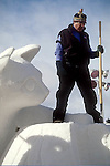 ICE SCULPTOR STANDS ALONGSIDE<br />