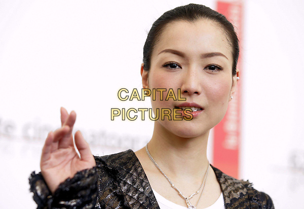 "SAMMI CHENG.62nd International Film Festival,.Photocall for the film ""Everlasting Regret"",.Venice, 8th September 2005.portrait headshot La Biennale silver crucifix jacket hand.Ref: G/OME.www.capitalpictures.com.sales@capitalpictures.com.© Capital Pictures."