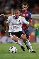 02/09/2012 - Liga Football Spain, FC Barcelona vs. Valencia CF Matchday 3 - Feghouli, argelian player from Valencia CF controls the ball against Mascherano, argentinian defense from FC BArcelona