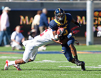 October 20th, 2012: California's Brendan Bigelow breaks a tackle from  Stanford's defender during a at Memorial Stadium at Berkeley, Ca   Stanford defeated California 21 - 3