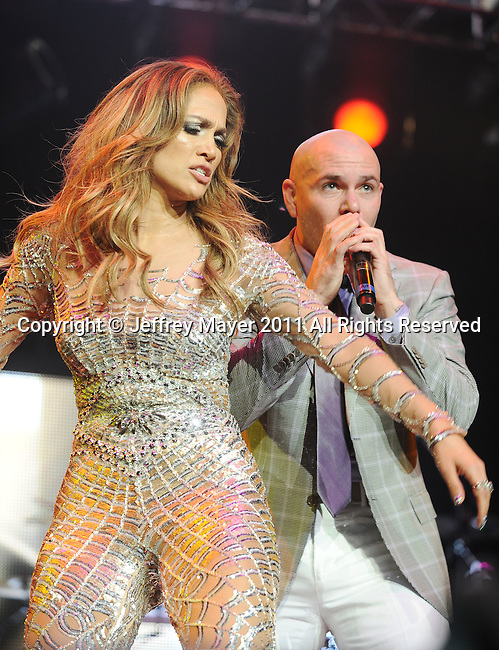 LOS ANGELES, CA - MAY 14: Jennifer Lopez and Pitbull  perform at KIIS FM's 2011 Wango Tango Concert at Staples Center on May 14, 2011 in Los Angeles, California.