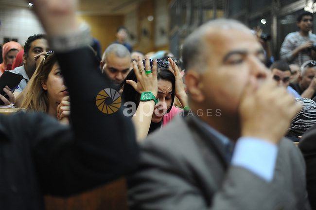 A supporter of Egypt's former president Hosni Mubarak, reacts after his verdict hearing in a retrial for embezzlement on May 9, 2015 in the capital Cairo. The Egyptian court sentenced Mubarak and his two sons to three years in prison. Photo by Stranger