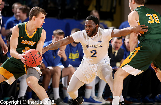 BROOKINGS, SD - FEBRUARY 1: Tevin King #2 from South Dakota State University fights through a screen to apply pressure to Paul Miller #2 from North Dakota State University during their game Thursday at Frost Arena in Brookings. (Photo by Dave Eggen/Inertia)
