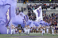 SEATTLE, WA - SEPTEMBER 9:  Washington cheer members lead the Washington Huskies out onto the field during the game between the Washington Huskies and the Montana Grizzlies on September 09, 2017 at Husky Stadium in Seattle, WA. Washington won 63-7 over Montana.