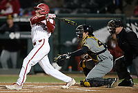 NWA Democrat-Gazette/ANDY SHUPE<br /> Arkansas third baseman Jacob Nesbit hits a sacrifice fly Friday, March 15, 2019, to score Matt Goodheart during the fourth inning against Missouri at Baum-Walker Stadium in Fayetteville. Visit nwadg.com/photos to see more photographs from the game.
