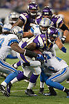 Minnesota Vikings running back Adrian Peterson (28) is tackled by the defense of the Detroit Lions during an NFL football game in Minneapolis, Minnesota on September 26, 2010. The Vikings won 24-10. (AP Photo/David Stluka)