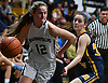 Falyn Dwyer #12 of Harborfields, left, looks to get inside the paint during the Suffolk County varsity girls basketball Class A semifinals against Shoreham-Wading River at Harborfields High School in Greenlawn, NY on Tuesday, Feb. 21, 2017. She scored a game-high 13 points in Harborfields' win.