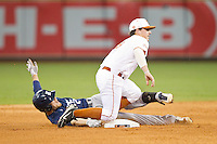 Shane Hoelscher #2 of the Rice Owls avoids the tag from Brooks Marlow #8 of the Texas Longhorns as he slides into second base with a double at Minute Maid Park on February 28, 2014 in Houston, Texas.  The Longhorns defeated the Owls 2-0.  (Brian Westerholt/Four Seam Images)
