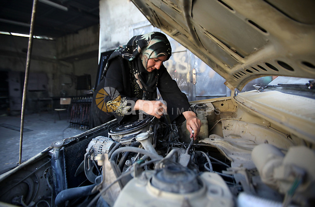 A Palestinian woman Ranim Safadi, 30-year-old, works at the metal workshop in the West bank village of Urif, near Nablus, on Oct. 18, 2016. Safadi is the first woman in the West bank works at the field of blacksmithing with her husband. Photo by Nedal Eshtayah