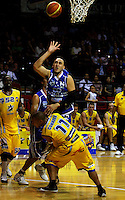 Leon Henry is blocked by Otago's Nat Connell during the NBL Basketball match between Wellington Saints and Otago Nuggets at TSB Bank Arena, Wellington, New Zealand on Sunday, 30 March 2008. Photo: Dave Lintott / lintottphoto.co.nz