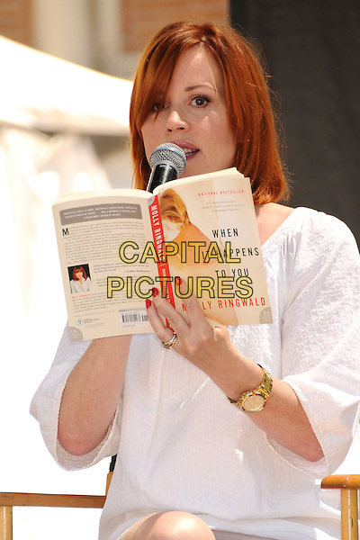 Molly Ringwald.18th Annual Los Angeles Times Festival of Books held at USC, Hollywood, California,USA, .20th April 2013..half length white holding book 'When It Happens To You' gold wrist watch microphone speaking reading .CAP/ADM/BP.©Byron Purvis/AdMedia/Capital Pictures