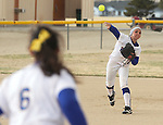 Western Nevada College shortstop Melanie Pfieffer throws to Ali-Marie Lostra at first base for an out during a college softball game in Carson City, Nev., on Friday, March 16, 2012..Photo by Cathleen Allison