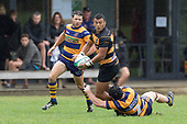 Liam Daniela looks for support as he gets tackled by Craig Jones. Premier Counties Power Club Rugby Round 3, Counties Power Game of the Week, between Patumahoe and Bombay, played at Patumahoe on Saturday March 24th 2018. <br /> Photo by Richard Spranger.<br /> <br /> Patumahoe Counties Power Cup Holders won the game 26 - 23 after trailing 7 - 23 at halftime.<br /> Patumahoe 26 - Penalty try, Richard Taupaki, Theodore Solipo, Craig Jones tries; Riley Hohepa 2 conversions. <br /> Bombay 23 - Shaun Muir, Jordan Goldsmith, Liam Daniela, tries; Tim Cossens conversion; Tim Cossens 2 penalties.