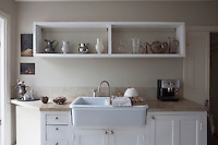 A collection of jugs stored on open shelving in the kitchen make a practical as well as visually appealing display