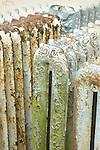 Rusted old radiators with peeling paint abstract.