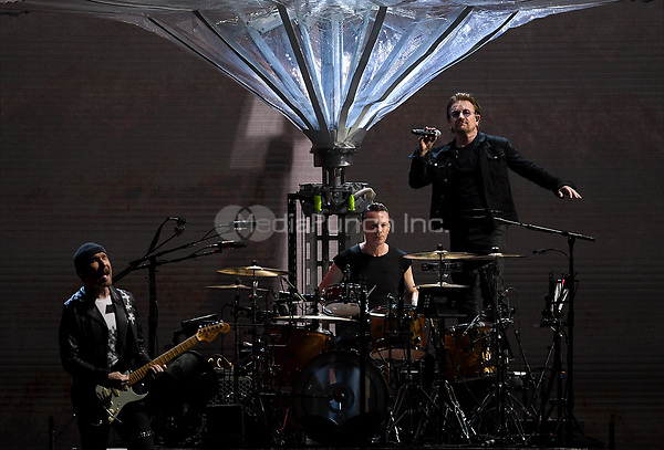 Musicians David Howell Evans (The Edge) (l-r), Larry Mullen junior and Paul David Hewson (Bono) of the Irish band U2 on stage at the Olympic Stadium in Berlin, Germany, 12 July 2017. Photo: Britta Pedersen/dpa-Zentralbild/dpa /MediaPunch ***FOR USA ONLY***