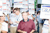 Republican presidential candidate Lindsey Graham greets people before marching in the Labor Day parade in Milford, New Hampshire.  Republican candidates John Kasich, Carly Fiorina, and Democratic candidate Bernie Sanders also marched in the parade.