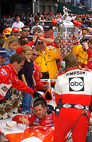 87th Indianapolis 500, Indianapolis Motor Speedway, Speedway, Indiana, USA  25 May,2003.Winner Gil de Ferran shows obvious pain when exiting his car in Victory Lane..World Copyright©F.Peirce Williams 2003 .ref: Digital Image Only..F. Peirce Williams .photography.P.O.Box 455 Eaton, OH 45320.p: 317.358.7326  e: fpwp@mac.com..