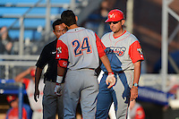 Williamsport Crosscutters outfielder Gustavo Martinez #24 talks to the team trainer and manager Nelson Prada #47 after fouling a pitch off his ankle during a game against the Jamestown Jammers on June 20, 2013 at Russell Diethrick Park in Jamestown, New York.  Jamestown defeated Williamsport 12-6.  (Mike Janes/Four Seam Images)