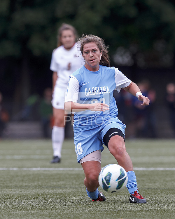 University of North Carolina forward Alexa Newfield (88) passes the ball.   University of North Carolina (blue) defeated Boston College (white), 1-0, at Newton Campus Field, on October 13, 2013.