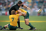 Richie McCaw of the All Blacks makes a break during the match of DHL Hong Kong Bledisloe Cup between New Zealand All Blacks and Australia Wallabies at Hong Kong Stadium on October 30, 2010 in Hong Kong, China.