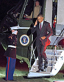 United States President Barack Obama salutes the Marine Guard as he arrives at the White House in Washington, DC following campaign stops in Fayetteville and Charlotte, North Carolina for Democratic presidential candidate Hillary Clinton on Friday, November 4, 2016.  <br /> Credit: Ron Sachs / CNP