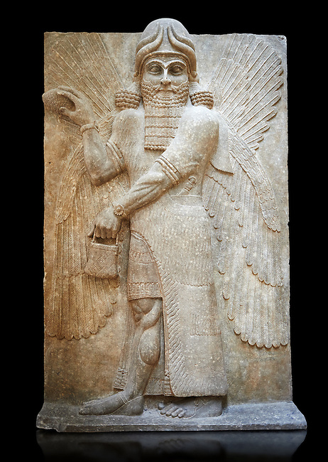 Stone relief sculptured panel of a Genie blessing. Gate No 3, Inv AO 19863 from Dur Sharrukin the palace of Assyrian king Sargon II at Khorsabad, 713-706 BC.  Louvre Museum Room 4 , Paris