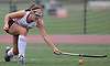 Julianne Larsson #10 of Garden City stretches to make a backhanded centering pass during a Nassau County Conference I varsity field hockey match against Baldwin at Garden City High School on Friday, Sept. 30, 2016. She scored two goals in Garden City's 7-0 win.
