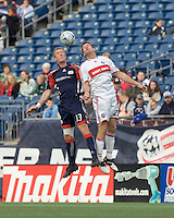 New England Revolution midfielder/defender Jeff Larentowicz (13) and Chicago Fire forward Brian McBride (20) battle for head ball. The New England Revolution out scored the Chicago Fire, 2-1, in Game 1 of the Eastern Conference Semifinal Series at Gillette Stadium on November 1, 2009.