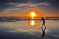 Walking and Surfing at the Beach During Sunset