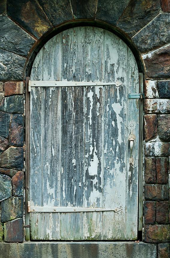 Old arched wooden door.