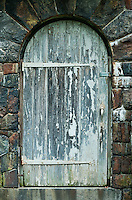 Old arched wooden door.