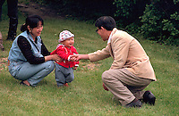 Asian family age 30 and 1 playing at Vietnam Wall on Memorial Day. St Paul Minnesota USA