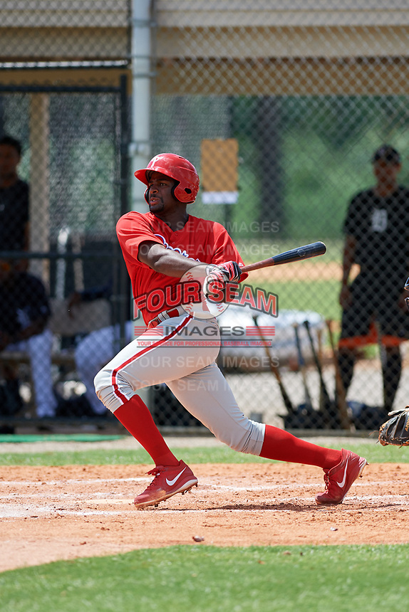 GCL Phillies third baseman D.J. Stewart (10) follows through on a swing during a game against the GCL Tigers East on July 25, 2017 at TigerTown in Lakeland, Florida.  GCL Phillies defeated the GCL Tigers East 4-1.  (Mike Janes/Four Seam Images)
