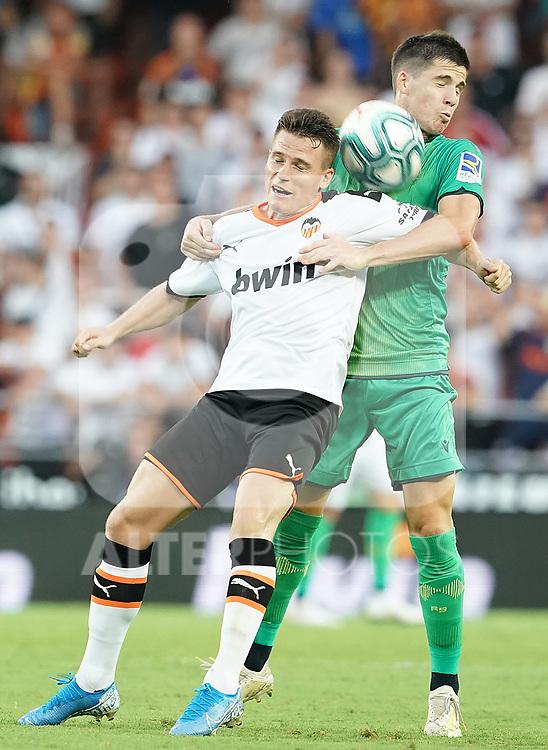 Valencia CF's Kevin Gameiro (l) and Real Sociedad's Igor Zubeldia during La Liga match. August 17,2019. (ALTERPHOTOS/Acero)