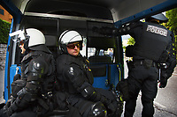 Switzerland. Canton Ticino. Lugano. Three police officers from TPO (Transport Police). The policemen wear the special riot police black uniforms and helmets. They seat inside the TPO van following the FC Luzern football club's supporters walking towards the Cornaredo stadium. The ultras fans can become violent at any time. TPO (Transport Police) is the Swiss Federal Railways Police. Swiss Federal Railways (German: Schweizerische Bundesbahnen (SBB), French: Chemins de fer fédéraux suisses (CFF), Italian: Ferrovie federali svizzere (FFS)) is the national railway company of Switzerland. It is usually referred to by the initials of its German, French and Italian names, as SBB CFF FFS. 2.06.2017 © 2017 Didier Ruef