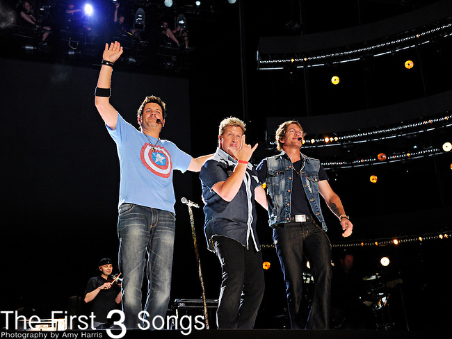Jay DeMarcus, Gary LeVox, and Joe Don Rooney of Racal Flatts perform at LP Field during the 2012 CMA Music Festival on June 10, 2011 in Nashville, Tennessee.