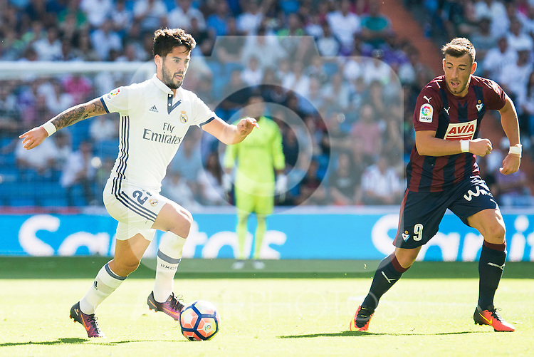 "Real Madrid's player Francisco Roman ""Isco"" and Eibar FC's player Sergi Enrich during a match of La Liga Santander at Santiago Bernabeu Stadium in Madrid. October 02, Spain. 2016. (ALTERPHOTOS/BorjaB.Hojas)"