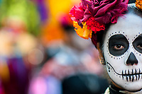 A young woman, dressed as La Catrina, a Mexican pop culture icon representing the Death, takes part in the Day of the Dead festivities in Mexico City, Mexico, 29 October 2016. Day of the Dead (Día de Muertos), a syncretic religious holiday combining the death veneration rituals of the ancient Aztec culture with the Catholic practice, is celebrated throughout all Mexico. Based on the belief that the souls of the departed may come back to this world on that day, people gather at the gravesites in cemeteries praying, drinking and playing music, to joyfully remember friends or family members who have died and to support their souls on the spiritual journey.