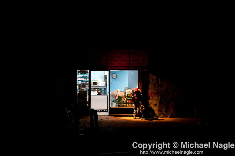 QUEENS, NY -- OCTOBER 25, 2013:   A man and a dog stand in front of a coffee shop in Willets Point on October 25, 2013 in Queens, NY.  PHOTOGRAPH  BY MICHAEL NAGLE FOR THE NEW YORK TIMES