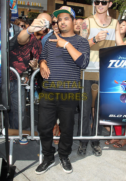 Michael Pena<br /> &quot;Turbo&quot; Party And Pop-Up Concert During E3 Gaming Convention held at Nokia Theatre L.A. Live, Los Angeles, California, USA.<br /> June 12th, 2013<br /> full length hand v peace sign fans blue stripe baseball cap hat posing taking picture photograph   <br /> CAP/ADM/RE<br /> &copy;Russ Elliot/AdMedia/Capital Pictures